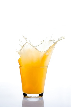 Orange juice splash on white background photo