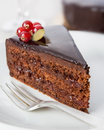Portion of chocolate cake served on a table Stock Photo