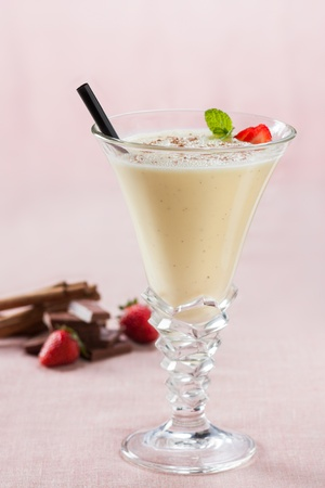 vanilla and chocolate milkshake on red fabric photo