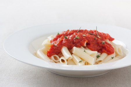 privat: plate of macaroni with tomato sauce and herbs