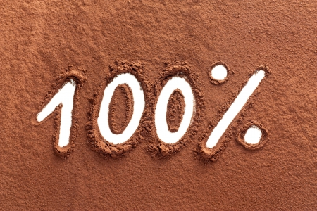 The word 100% written on cocoa powder photo