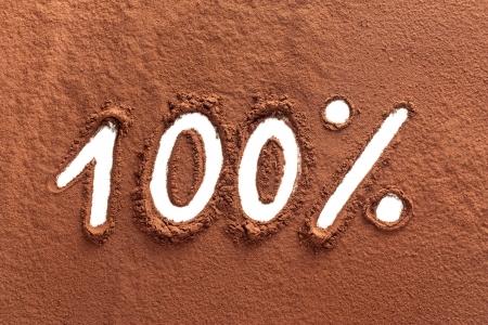 cocoa powder: The word 100% written on cocoa powder Stock Photo