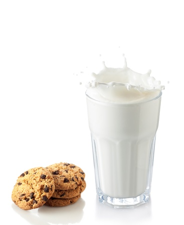 privat: splash of milk glass with chocolate cookies Stock Photo