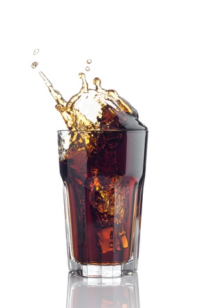splash in glass of cola with ice cubes isolated