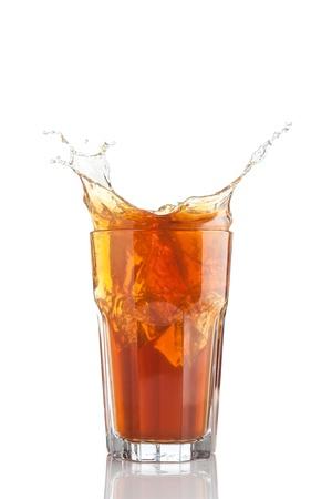 splash of iced tea isolated on white background