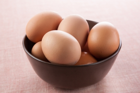 bowl of fresh brown eggs photo