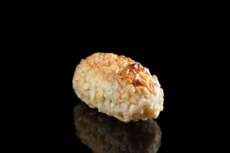 Almond panellet isolated on black photo