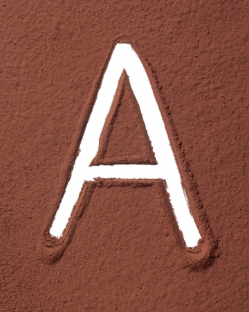 Letter A uppercase made of cocoa powder photo