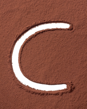 Letter C uppercase made of cocoa powder photo