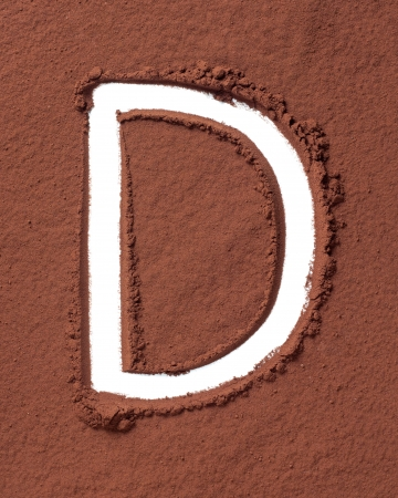Letter D uppercase made of cocoa powder photo