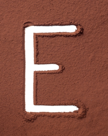 Letter E uppercase made of cocoa powder photo