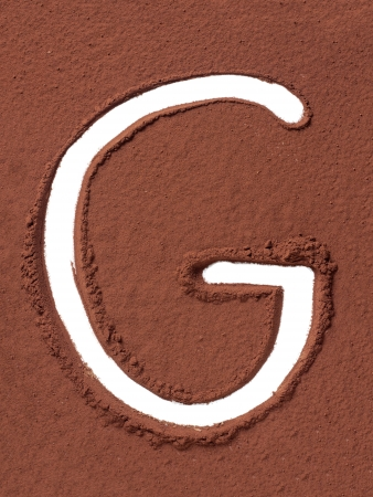 Letter G uppercase made of cocoa powder photo