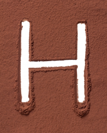 Letter H uppercase made of cocoa powder photo