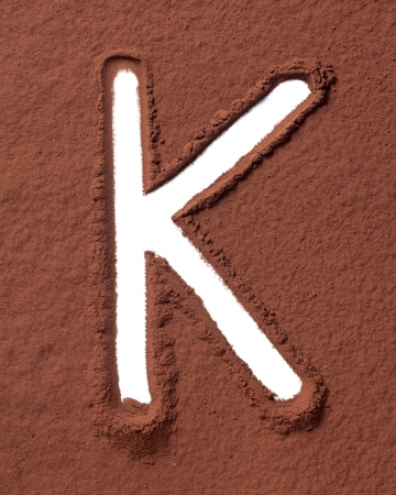 Letter K uppercase made of cocoa powder photo