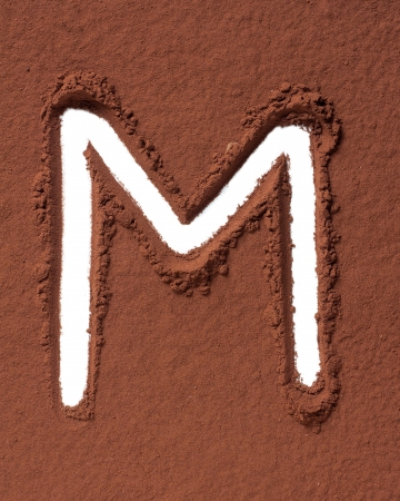 Letter M uppercase made of cocoa powder photo