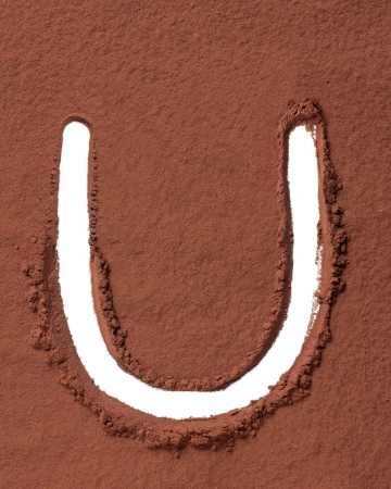 Letter U uppercase made of cocoa powder photo