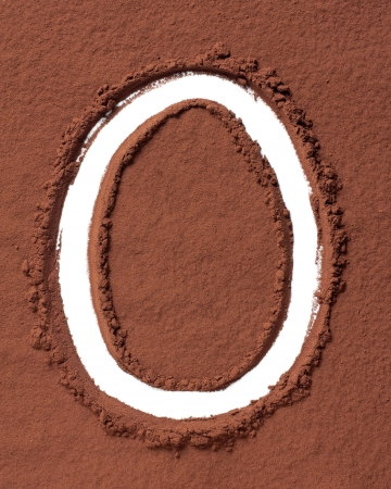Letter O uppercase made of cocoa powder photo