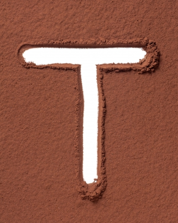 Letter T uppercase made of cocoa powder photo