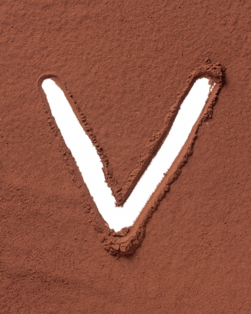 Letter V uppercase made of cocoa powder photo
