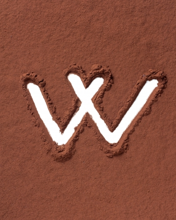 Letter W uppercase made of cocoa powder photo