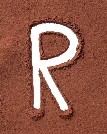 Letter R uppercase made of cocoa powder photo