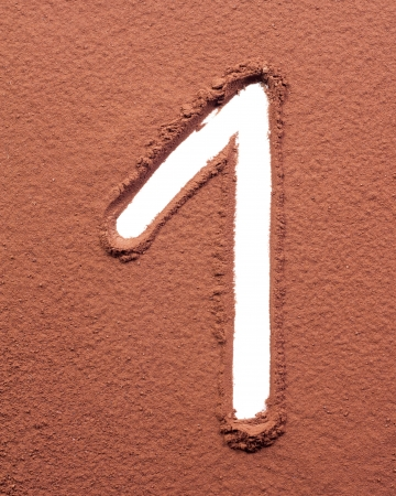 Number 1 made of cocoa powder on white background photo