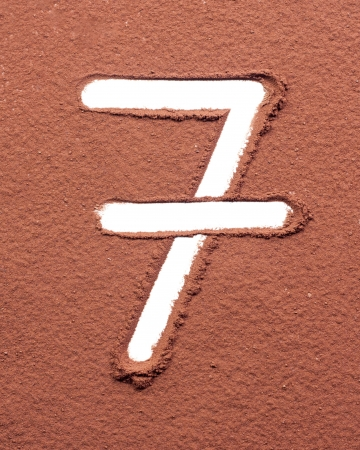 Number 7 made of cocoa powder on white background photo