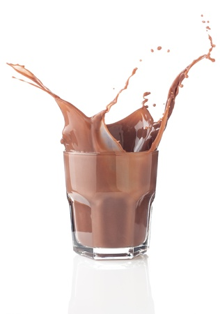 Chocolate splash in a glass isolated on white photo
