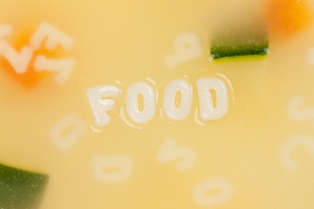 Alphabet soup drawing the word Food close-up photo