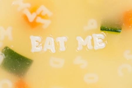 Alphabet soup drawing the words Eat Me close-up photo