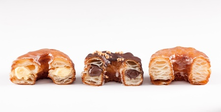Chocolate, cream and original croissant and doughnut mixture isolated on white Stock Photo