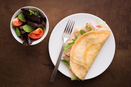 Cheese and ham crepe with salad overview Stock Photo - 21860574