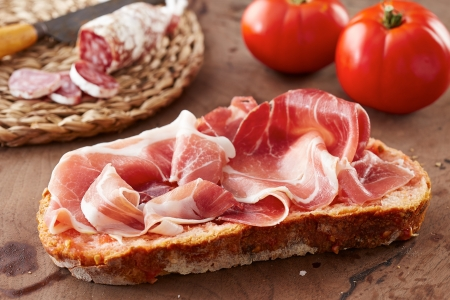 Bread with tomato, ham and cold meat