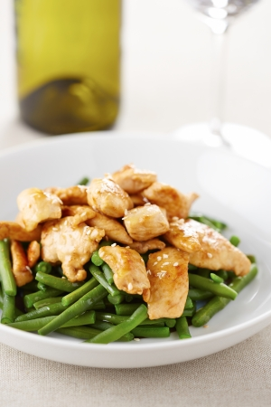 Grilled chicken breast with green beans on a dish photo