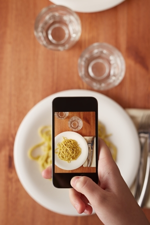 handphone: Hands taking photo of Italian pasta lunch with smartphone