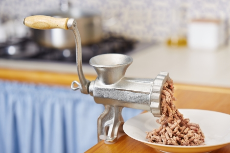 Traditional meat grinder in domestic kitchen photo