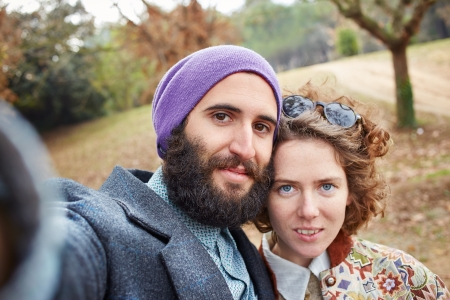 Selfie of a young hipster couple outdoors photo