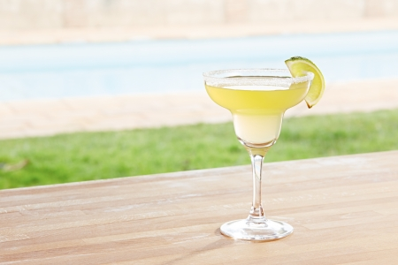 Margarita cocktail on poolside bar photo
