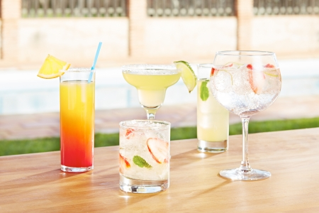 Variety of summer cocktails by the poolside photo