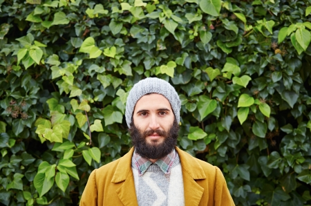 Smiling hipster bearded male student in vintage clothes photo