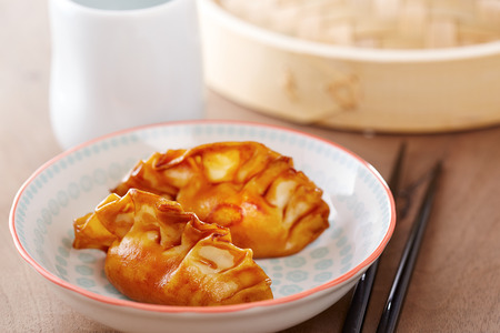 Cooked dim sums chinese dumplings with soy sauce photo
