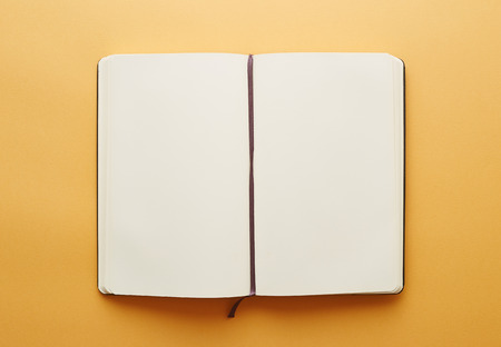 Copy space blank notebook on yellow background Stock Photo