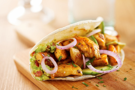 Mexican chicken taco with avocado and onion