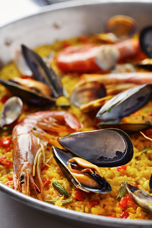Typical spanish seafood paella in traditional pan photo