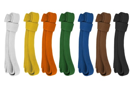 aikido: Martial art belts in consecutive colors. Isolated on white. Stock Photo