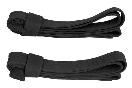 Martial art black belt from two angles. Isolated on white.