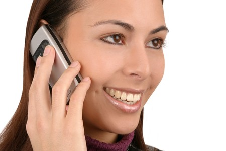 Young attractive woman talking on a cell phone. photo