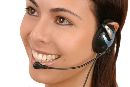 Friendly, attractive operator with headset.