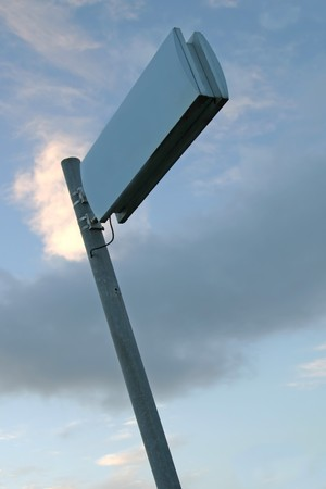 Empty sign against clouded sky. Add your own text.