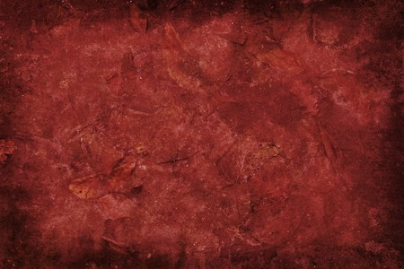 Red grunge background with leaves.